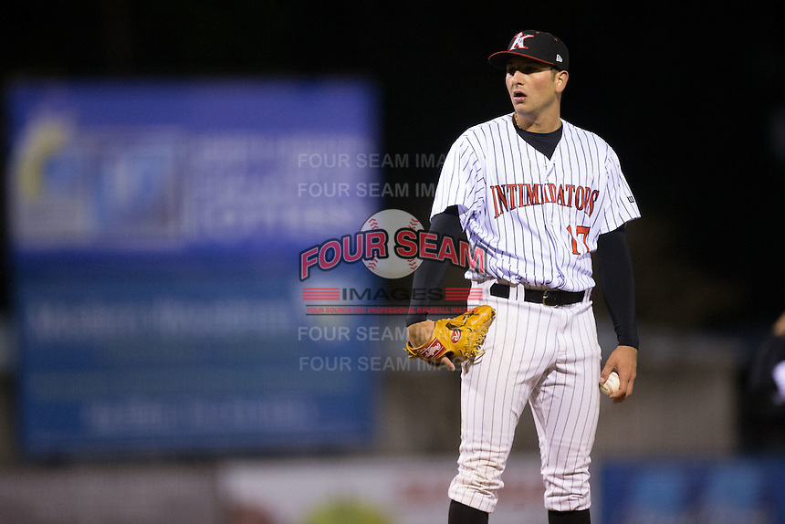 Kannapolis Intimidators relief pitcher Ryan Hinchley (17) looks to his catcher for the sign against the Hickory Crawdads at Kannapolis Intimidators Stadium on April 9, 2016 in Kannapolis, North Carolina.  The Crawdads defeated the Intimidators 6-1 in 10 innings.  (Brian Westerholt/Four Seam Images)