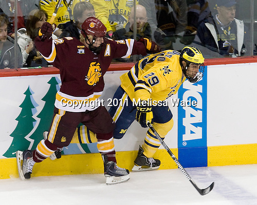 Mike Connolly (Duluth - 22), Louie Caporusso (Michigan - 29) - The University of Minnesota-Duluth Bulldogs defeated the University of Michigan Wolverines 3-2 (OT) to win the 2011 D1 National Championship on Saturday, April 9, 2011, at the Xcel Energy Center in St. Paul, Minnesota.