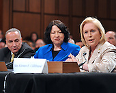 Washington, DC - July 13, 2009 -- United States Senator Kirsten Gillibrand (Democrat of New York), right, makes her introductory remarks about Judge Sonia Sotomayor's, center, nomination as Associate Justice of the U.S. Supreme Court before the U.S. Senate Judiciary Committee considers the nomination of  on Monday, July 13, 2009.  U.S. Senator Chuck Schumer (Democrat of New York) looks on from left..Credit: Ron Sachs / CNP