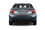 Straight rear view of a 2017 Toyota Corolla L 4 Door Sedan stock images