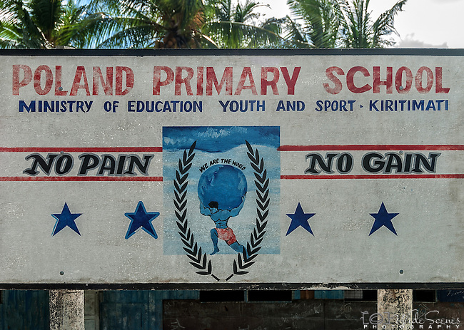 A sign for Poland Primary School which is in a remote part of the island of Kiritimati in Kiribati.