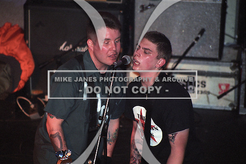 Ken Casey (bass) and James Lynch (guitar) of the Dropkick Murphys performs at Water Street Music Hall in Rochester, New York circa March 2001.  Editors Note:  Date and venue not certain.  Photo Copyright Mike Janes Photography