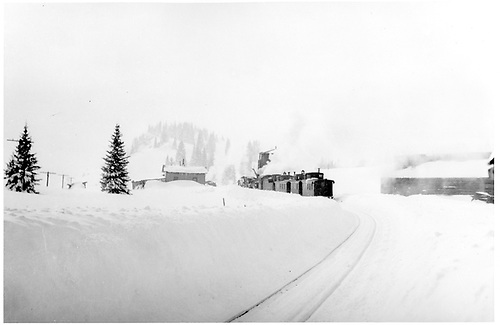Snow removal train at Cumbres station section house.<br /> D&amp;RGW  Cumbres, CO  10/1942