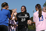 23 October 2011: Duke senior Emily Nahas (20) is honored by her teammates as part of Duke's Senior Day. The Duke University Blue Devils defeated the University of Maryland Terrapins 3-1 at Koskinen Stadium in Durham, North Carolina in an NCAA Division I Women's Soccer game.