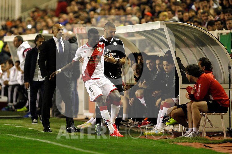 Benzema of Real Madrid and Paco Jemez and Fatau of Rayo Vallecanoduring La Liga match between Rayo Vallecano and Real Madrid at Vallecas Stadium in Madrid, Spain. April 08, 2015. (ALTERPHOTOS/Caro Marin)