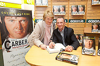 NO REPRO FEE.8/10/2011. Eason, Ireland's leading retailer of books, stationery, magazines and lots more, hosted a book signing by Jockey, Paul Carberry.  Pictured at Eason, O'Connell Street, Dublin is fan Josephine Griffin from Parnell st and Paul Carberry who signed copies of his new autobiography One Hell of a Ride. Follow Eason on Twitter - @easons For further information, please contact: Aoife McDonald WHPR 087 4100777 . Picture James Horan/Collins Photos