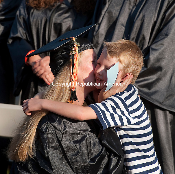WINSTED, CT--052815JS05-  Northwestern Connecticut Community College graduate Heleen Steenbergen Maloy of New Hartford,  gets a hug from her son Jim Maloy, 6, prior to graduation ceremonies Thursday at East End Park in Winsted. Heleen received her Associates in Arts degree in Deaf Studies. <br />  Jim Shannon Republican-American