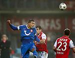 Nederland, Alkmaar, 21 december 2012.Eredivisie .Seizoen 2012-2013.AZ-FC Twente.Nacer Chadli van FC Twente kopt de bal weg. Rechts Dirk Marcellis (2e van rechts.) van AZ en Roy Beerens (r.) van AZ