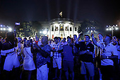 Guests react on the South Lawn of the White House during a fireworks display in Washington, D.C., U.S., on Wednesday, July 4, 2018. Trump's campaign won the technical knockout of a lawsuit filed by two Democratic National Committee donors and a DNC staffer who accused it of colluding with Russian to publish compromising information about the Clinton campaign on WikiLeaks that included details about their lives. <br /> Credit: Yuri Gripas / Pool via CNP