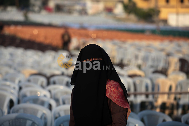 A Palestinian woman attends the Hamas festival in Gaza City, March 22, 2014. Hamas organized a festival in the anniversary of the death of Hamas leaders Sheikh Ahmed Yassin, Ibrahim Makadmeh, and Abdul Aziz Rantisi. Photo by Ashraf Amra