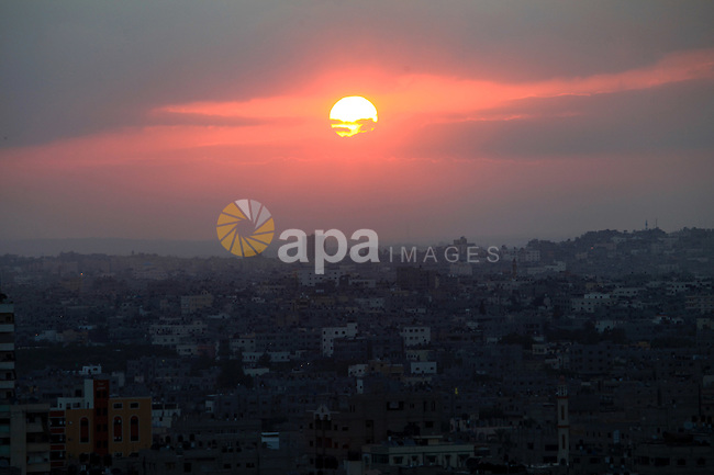 The Sunrise on the Gaza Strip, as seen from the Israel-Gaza border, on Saturday, July 19, 2014. Israeli forces on Saturday pressed ahead with a ground offensive in the Gaza Strip, where Palestinian militants kept firing rockets deep into Israel's heartland, pushing the death toll past 300 in almost two weeks of conflict. Photo by Mohammad Othman