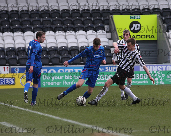 Mark Williams tackles Ryan Christie as Nick Ross (7) and Adam Brown look on in the St Mirren v Inverness Caledonian Thistle Clydesdale Bank Scottish Premier League Under 20 match played at St Mirren Park, Paisley on 2.4.13.