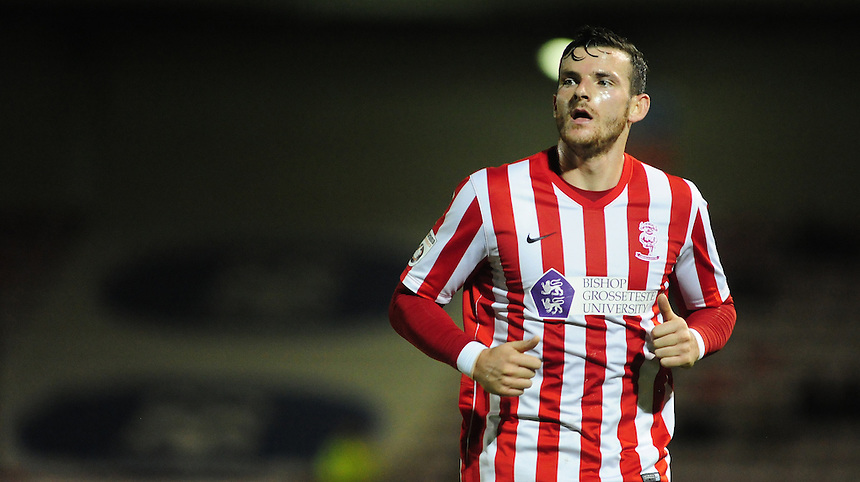 Lincoln City's Sean Newton who scored a hat-trick in Lincoln City 5-1 win over Alfreton Town<br /> <br /> Photo by Chris Vaughan/CameraSport<br /> <br /> Football - FA Challenge Cup Fourth Qualifying Round replay - Lincoln City v Alfreton Town - Tuesday 28th October 2014 - Sincil Bank - Lincoln<br /> <br /> &copy; CameraSport - 43 Linden Ave. Countesthorpe. Leicester. England. LE8 5PG - Tel: +44 (0) 116 277 4147 - admin@camerasport.com - www.camerasport.com