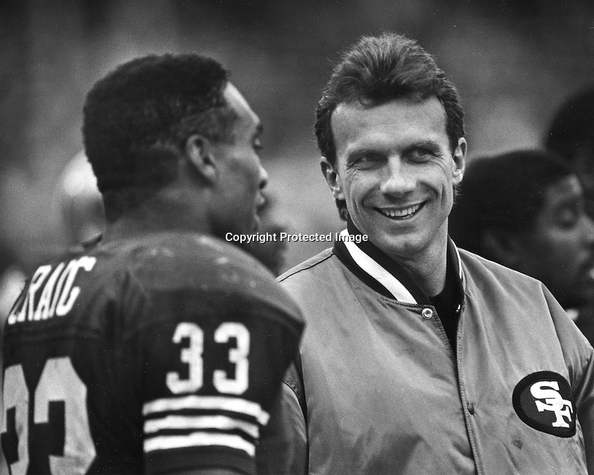 San Francisco 49ers Roger Craig and quarterback Joe Montana share a good moment. (1989 photo by Ron Riesterer)