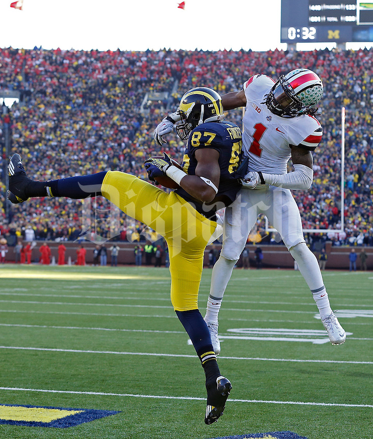 Ohio State Buckeyes cornerback Bradley Roby (1) can't stop Michigan Wolverines tight end Devin Funchess (87) from making a touchdown catch in the 4th quarter of their college football game at Michigan Stadium in Ann Arbor, Michigan on November 30, 2013.  (Dispatch photo by Kyle Robertson)