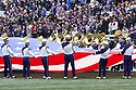SEATTLE, WA - SEPTEMBER 14: Washington band members held the USA flag during the playing of the National Anthem before the college football game between the Washington Huskies and the Hawaii Rainbow Warriors on September 14, 2019 at Husky Stadium in Seattle, WA. Jesse Beals / www.Olympicphotogroup.com