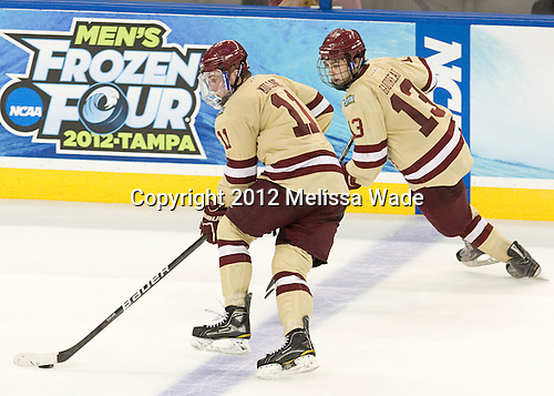 Pat Mullane (BC - 11), Johnny Gaudreau (BC - 13) - The Boston College Eagles defeated the University of Minnesota Golden Gophers 6-1 in their 2012 Frozen Four semi-final on Thursday, April 5, 2012, at the Tampa Bay Times Forum in Tampa, Florida.