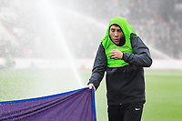 A ball boy gets a soaking form sprinklers prior  to kick off during AFC Bournemouth vs Arsenal, Premier League Football at the Vitality Stadium on 25th November 2018