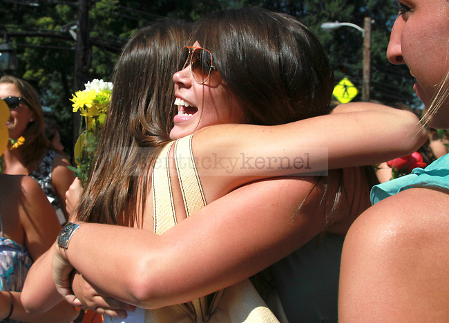 Two Alpha Delta Pi sorority pledges embrace in celebration at their sorority house to celebrate bid day on August 20, 2010.