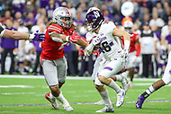 Indianapolis, IN - December 1, 2018: Ohio State Buckeyes defensive end Chase Young (2) tries to tackle Northwestern Wildcats wide receiver Berkeley Holman (16) during the Big Ten championship game between Northwestern  and Ohio State at Lucas Oil Stadium in Indianapolis, IN.   (Photo by Elliott Brown/Media Images International)