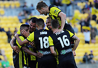 Phoenix players celebrate Sarpreet Singh's goal during the A-League football match between Wellington Phoenix and Central Coast Mariners at Westpac Stadium in Wellington, New Zealand on Saturday, 15 December 2018. Photo: Dave Lintott / lintottphoto.co.nz