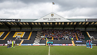 The teams stand for a minutes silence in memory of the terrorist attacks around the world during the Sky Bet League 2 match between Notts County and Wycombe Wanderers at Meadow Lane, Nottingham, England on 28 March 2016. Photo by Andy Rowland.