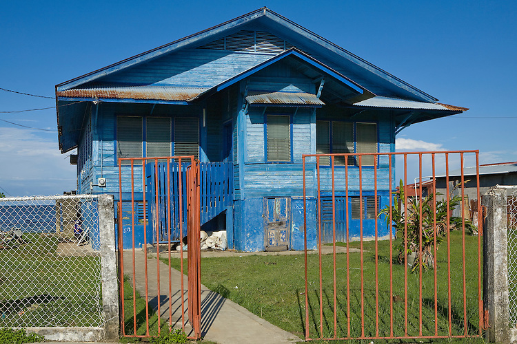 A deep blue house on the water demonstrates the classic Caribbean architecture of the region, Bocas del Toro, Panama