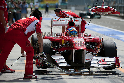 Ferrari Formula One driver Fernando Alonso of Spain stops in the pit during the free testing session of the Hungarian F1 Grand Prix in Mogyorod (about 20km north-east from Budapest), Hungary. Saturday, 30. July 2011. ATTILA VOLGYI