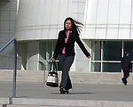 Newsday Reporter, Chau Lam leaving Suffolk Federal Courthouse in Hauppauge, May 1, 2003. Photo by Jim Peppler. Copyright Jim Peppler 2003.