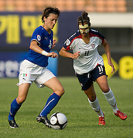 USWNT midfielder (11) Carli Lloyd moves in on Italy's (4) Alessia Tuttino during the last group stage game at the Peace Queen Cup.  The USWNT defeated Italy, 2-0, at the Suwon Sports Center in Suwon, South Korea.