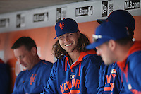 SAN FRANCISCO, CA - JULY 8:  Jacob deGrom of the New York Mets smiles in the dugout during the game against the San Francisco Giants at AT&T Park on Wednesday, July 8, 2015 in San Francisco, California. (Photo by Brad Mangin)