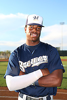 Monte Harrison #8 of the AZL Brewers poses before a game against the AZL Reds at the Cincinnati Reds Baseball Complex on July 5, 2014 in Goodyear, Arizona. (Larry Goren/Four Seam Images)