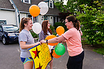 WATERTOWN, CT. 04 June 2020-060420BS238 - Katie Washburn, right, a friend of the Holly family stops to congratulate both Abbey, left, and Morgan Holly, two of the quad captains on the Watertown Girls Tennis team during a Girls Tennis Team car parade on Thursday. Bill Shettle Republican-American