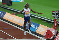 Mo Farah of GBR (Men's 3000m) celebrates his victory at the finish line during the Sainsburys Anniversary Games Athletics Event at the Olympic Park, London, England on 24 July 2015. Photo by Andy Rowland.