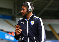 Riyad Mahrez of Leicester City arrives before the Barclays Premier League match between Swansea City and Leicester City played at The Liberty Stadium on 5th December 2015