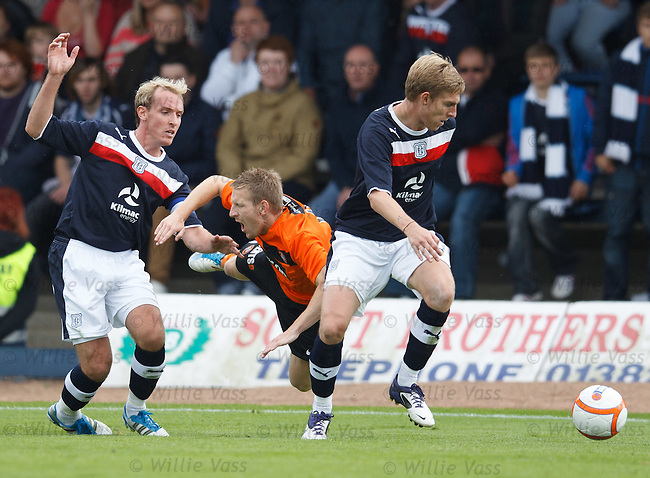 No way through for Michael Gardyne as he is checked by Gary Irvine
