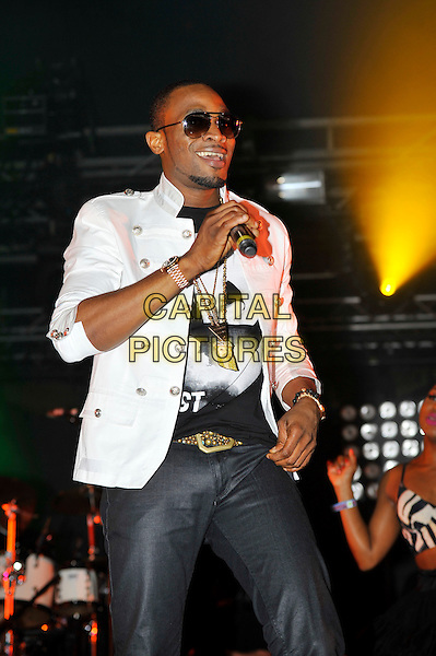 Dapo Daniel Oyebanjo aka D'banj .performing at the Barclaycard Wireless Festival, Hyde Park, London, England. 7th July 2012..music live gig on stage show half length   sunglasses jeans white jacket black t-shirt microphone .CAP/MAR.© Martin Harris/Capital Pictures.