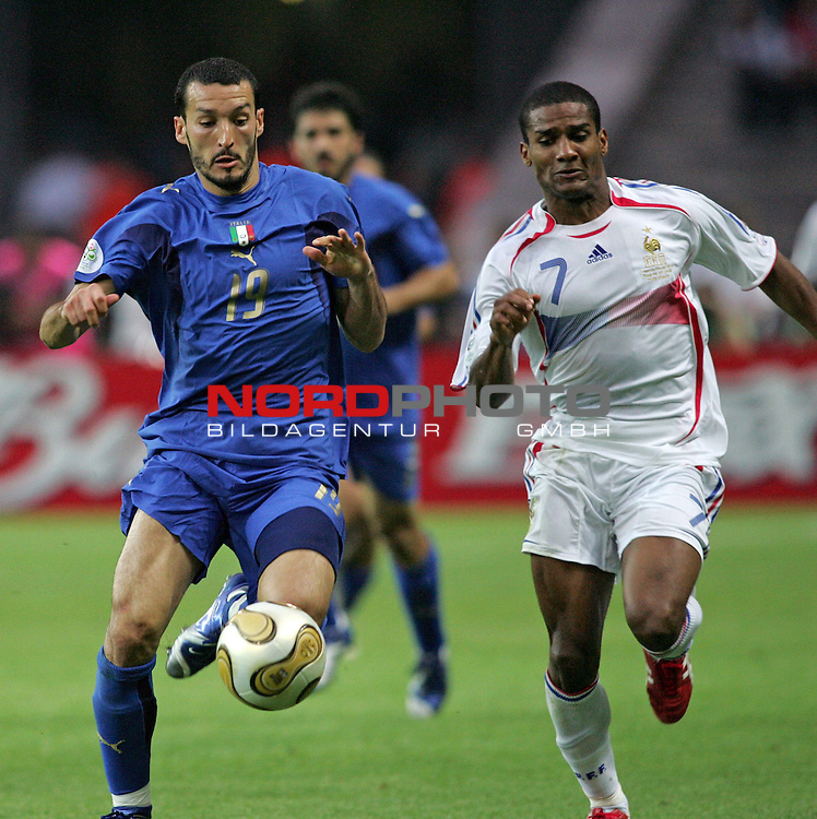 FIFA WM 2006 - Final / Finale<br /> <br /> Play #64 (09-Jul) - Italy vs France.<br /> <br /> Gianluca Zambrotta (r) from Italy and Florent Malouda (l) from France fight for the ball during the match of the World Cup in Berlin.<br /> <br /> Foto &copy; nordphoto