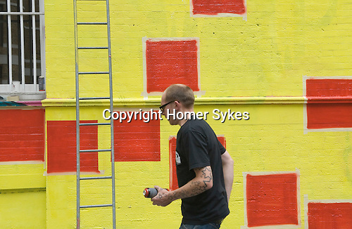 Ben Eine Stencil Street Artist. Creating new work in Middlesex Street London E1 (real name Ben Flynn)
