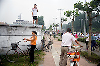 Spectators return home after the completion of the southern portion of the Nanjing, China, leg of the 2008 Olympic Torch Relay.  .