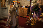 Reverend Hieromonk Leontije raises the flower-enshrined icon of  during the Exaltation (Elevation) of the Holy Cross liturgy service, inside the Church of the Ascension of Jesus Christ at the Monastery Mileševa, Serbia originally built in the 13th century.