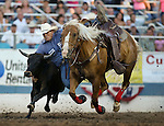 Beau Clark competes in the steer wrestling event at the Reno Rodeo in Reno, Nev., on Thursday, June 27, 2013.<br /> Photo by Cathleen Allison