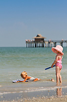 Kids play in Gulf of Mexico at Naples Beach at historic Naples Fishing Pier. Photo by Debi Pittman Wilkey