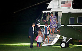 Washington, DC - July 12, 2009 -- United States President Barack Obama (L), First Lady Michelle Obama (R) and the daughters Sasha (2L) and Malia (2R) get of Marine One on the South Lawn of the White House, Sunday, July 12, 2009.  President Obama and the first family returned home to the White House in the early morning after a trip overseas to Russia, Europe, Africa and a G-8 meeting..Credit: Brendan Smialowski - Pool via CNP