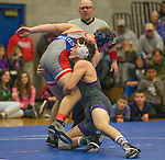 Spanish Springs Cougars Blake Boswell, right, wrestles Reno Huskies   in the 145 pound weight class on Wednesday night, January 13, 2016 at Reno High School.