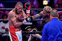 """Fairfax, VA - May 11, 2019:  Jarrett """"Swift"""" Hurd lands a right cross during Jr. Middleweight title fight at Eagle Bank Arena in Fairfax, VA. Julian Williams defeated Hurd to take home the IBF, WBA and IBO Championship belts by unanimous decision. (Photo by Phil Peters/Media Images International)"""