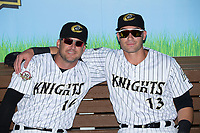 Ryan Raburn (16) and Nicky Delmonico (13) pose for a photo prior to the game against the Durham Bulls at BB&T BallPark on May 16, 2017 in Charlotte, North Carolina.  The Knights defeated the Bulls 5-3. (Brian Westerholt/Four Seam Images)