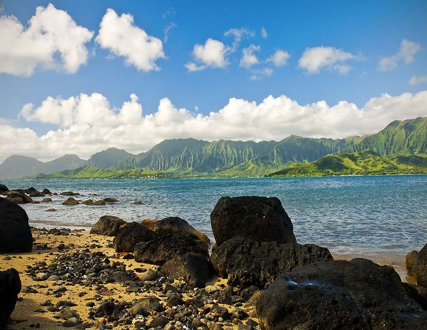 Oahu as seen from Chinaman's Hat in the morning light.  Photographer kayaks out to Mokolii Island with friend and three year old.