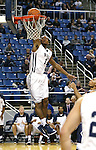 Nevada's D.J. Fenner (15) dunks against Utah State during an NCAA college basketball game in Reno, Nev., on Tuesday, Jan. 20, 2015. Utah State won 70-54. (AP Photo/Cathleen Allison)