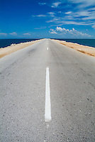 White dividing line marking a road going to Cayo Santa-Maria, Cuba.